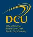 dcu_logo_stacked_slate_yellow-01